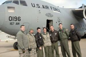 After the first local training sortie of a C-17 at the 167th Airlift Wing, West Virginia Air National Guard base in Martinsburg, Dec. 18, ground crew and those aboard the historic flight stand in front of the aircraft: Staff Sgt. Mark A. Kelley Jr. (left), Master Sgt. Joseph S. Bosacco, Capt. Justin S. McCabe, Lt. Col. Lisa Windle, Master Sgt. Charles R.D. Moore, Capt. Christopher K. Nary and Chief Master Sgt. Leslie Y. Morris. (Air National Guard photo by Staff Sgt. Sherree Grebenstein/released)