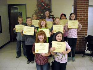Frankford Elementary School students display their spelling bee participation awards.