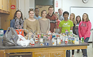 Some of the many GoGlobal-Interact students responsible for hauling and packing all the collected food items in this year's GEHS Fill the Food Banks Campaign.