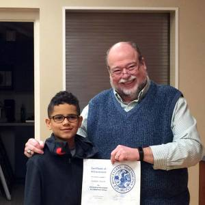 Ronceverte Elementary School student Jaidyn Smith is honored for winning the regional hoop shoot by Mayor David Smith. Jaidyn will go to the state hoop shoot championships in Huntington on Jan. 17.
