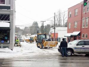 Crews worked downtown on Thursday, Feb. 18 clearing parking spaces in Lewisburg. (Photo Courtesy of Kathy Hunter)