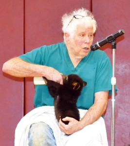Joel Rosenthal feeds Pancake, one of three bear cubs he's caring for at his Pocahontas County animal sanctuary, Point of View Farm.