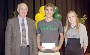 David Yarid Memorial Scholarship recipient from Greenbrier East High School Malachi McCutcheon (center) receives his award from Tim Holbrook, executive director of the Foundation and GEHS teacher, Kristi Haddox.