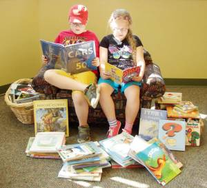 Beckley residents Aaron and Haley Jo Anderson enjoying the reading selection of the Greenbrier County Public Library, which is offering bargains on used books at its annual Book Bazaar noon to 6 p.m. Friday, Aug. 7 and 9 a.m. to 2 p.m. Saturday, Aug. 8 at 152 Robert W. McCormick Drive in downtown Lewisburg.