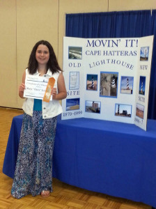 "Mary ""Chris"" Scronce posing with her ""Cape Hatteras Lighthouse"" poster at State 4-H Days."