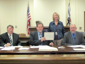 Karen Jones of the Robert C. Byrd Clinic joined Greenbrier County Commissioners Woody Hanna (left), Michael McClung and Lowell Rose in proclaiming October Breast Cancer Awareness Month at the Tuesday meeting of the Greenbrier County Commission. The proclamation urges all Greenbrier County women to discuss breast cancer screenings with their health care providers.