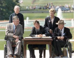 President George Bush signing the 1990 ADA into law