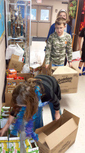 The Smoot Elementary National Honor Society teamed up with Meadow Grove Baptist Church and the Smoot 4-H club to provide 32 complete Thanksgiving meal boxes to families in Western Greenbrier County. Each box contained a turkey, mashed potatoes, stuffing, green beans, yams, cranberry sauce, pumpkin pie and rolls. Pictured: Cora Kesterson, Sawyer Burns and Arabella Crookshanks.