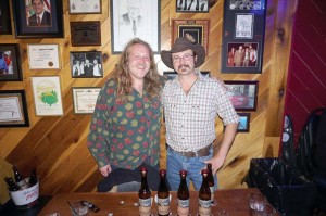 Local entrepreneurs Will Lewis and Josh Bennett were on site for the Hawk Knob Release Party on Dec. 19 at the Irish Pub. The duo were educating new consumers and giving out samples of their first release of four hard ciders brewed and bottled locally. (Photo by Rocio España)