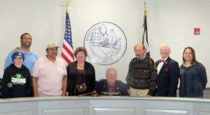 Lewisburg Mayor John Manchester signs Lewisburg's Martin Luther King, Jr. Week proclamation. With seated Mayor (center) are: Adam Seams (left), Danny Seams, Clifford Curry, Susanna Robinson-Kenga, Steve Rutledge, Larry Davis and Jaime Wykle.