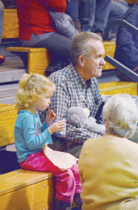 Short stuff takes a sip Sage Short, 4, sips on her drink and watches a basketball game between Greenbrier East's Lady Spartans and the Jefferson High School Cougars, Friday evening, Jan. 8. Sage attended the game with her great-grandmother, Betty White, and a friend, Roger Boggs. All three are from Frankford. (Photo by Mark Robinson)