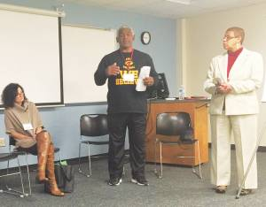 Facilitators Ray Lee (center) and Beverly White (right) lead a discussion group at the Summit on Race Matters in November. Rachel Kelly and others shared experiences and ideas.