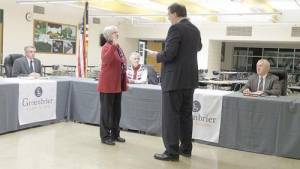 Judge Robert Richardson (right) swears in Kathy King to the Greenbrier County Board of Education. King will fill Stephen Baldwin Jr.'s unexpired term. Baldwin left the board last month to run for the West Virginia House of Delegates.