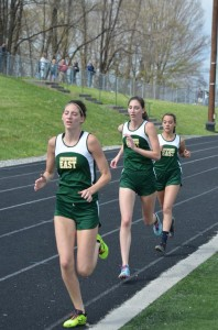 Midway through the girls 1600 Meter Run, Lauren Lindsay, Megan Lindsey, and Kaeley Boyd, in that order, held the lead. The three finished in the first three slots, with Boyd finishing first, Lauren second, and Megan third, to give Greenbrier East the first three places in a race that involved 17 competitors from seven schools. (Mark Robinson photo)