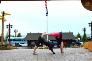 Double Downward Dog – Kristi Stemple and Joan Kesselring demonstrate a twist on a downward dog at the 2016 Wanderlust.