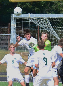 Brandon Barnes, playing for Greenbrier East's soccer team, goes high to help a corner kick, working in a pack of players, including the Martinsburg goalie. Martinsburg visited East last Saturday. East won, 7-3 (Mark Robinson photo)