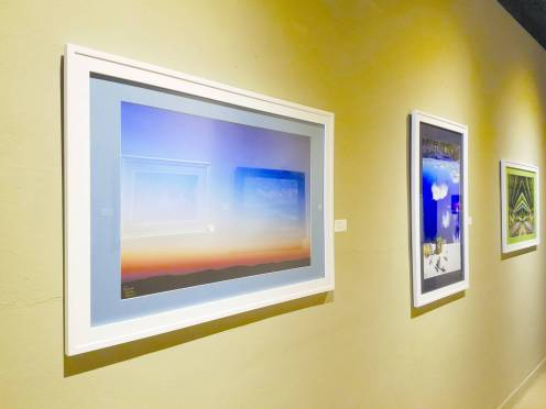 """(Photo by Sarah Richardson) Photography pieces by Nima ShahabShahmir hang in the lower level of """"E"""" building."""