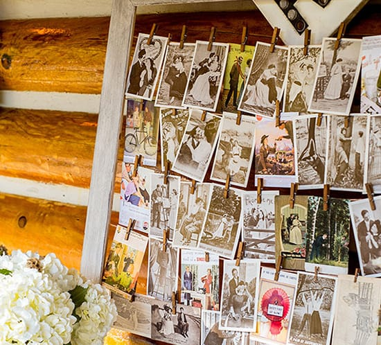 DIY Yarn Clothespin Frame on guestbook table with vintage postcards ahandcraftedwedding photo mountainmodernlife.com