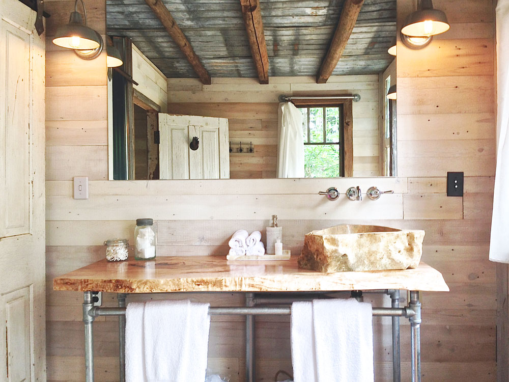 Rustic Treehouse Bathroom with Corrugated Metal Accents   Lynn Knowlton