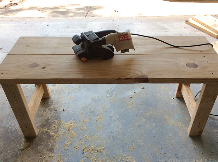See how we created a simple and rustic wood bench using lumber that didn't work out for the project it was originally intended for. MountainModernLife.com