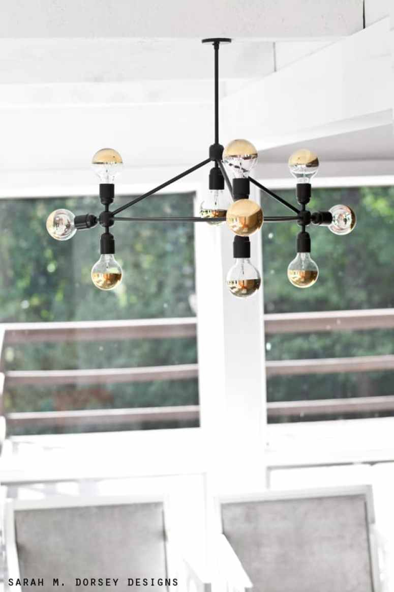 Thinking about making your own light fixture? You've gotta check out these DIY Modern Light Fixtures you won't believe are handmade! Photo: DIY Light Fixture from Sarah M Dorsey Designs