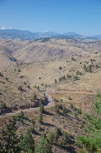 The Lariat Trail, built in 1913 as a cooperative effort between Denver, Jeffco, and the state, provides access to Windy Saddle Park (JCOS) and Lookout Mountain Park (DMP). At Windy Saddle, shown here, a new parking area connects the Chimney Gulch Trail (JCOS) with the historic Beaver Brook Trail (DMP). Photo by John Fielder.