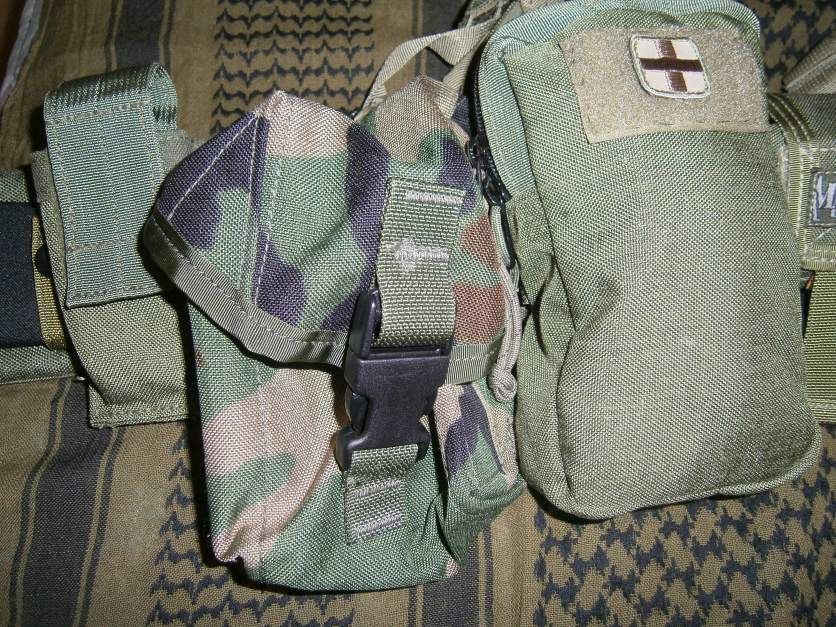 The right side of the belt;small pouch that can accept pistol mag,flashlight,multitool or a tourniquet,the woodland camo pouch and the IFAK pouch