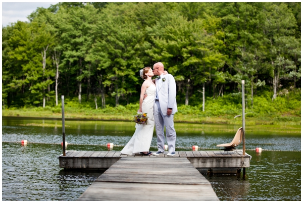 western maryland bride and groom kiis by a lake