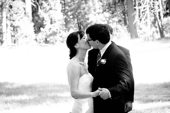 First kiss at Yosemite wedding ceremony