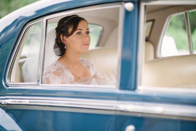 bride in blue rolls royce