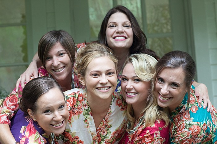 bride and bridesmaids in floral robes