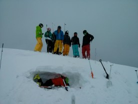 First digging a snow hole, then tickling our instructor with our probes