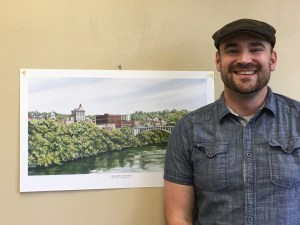 Fairmont planner Shae Strait has a photo of Fairmont hanging in his office.  Photo of Emily Allen