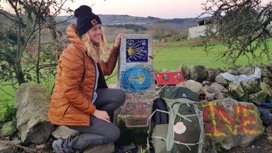 A female hiker on the Camino de Santiago.