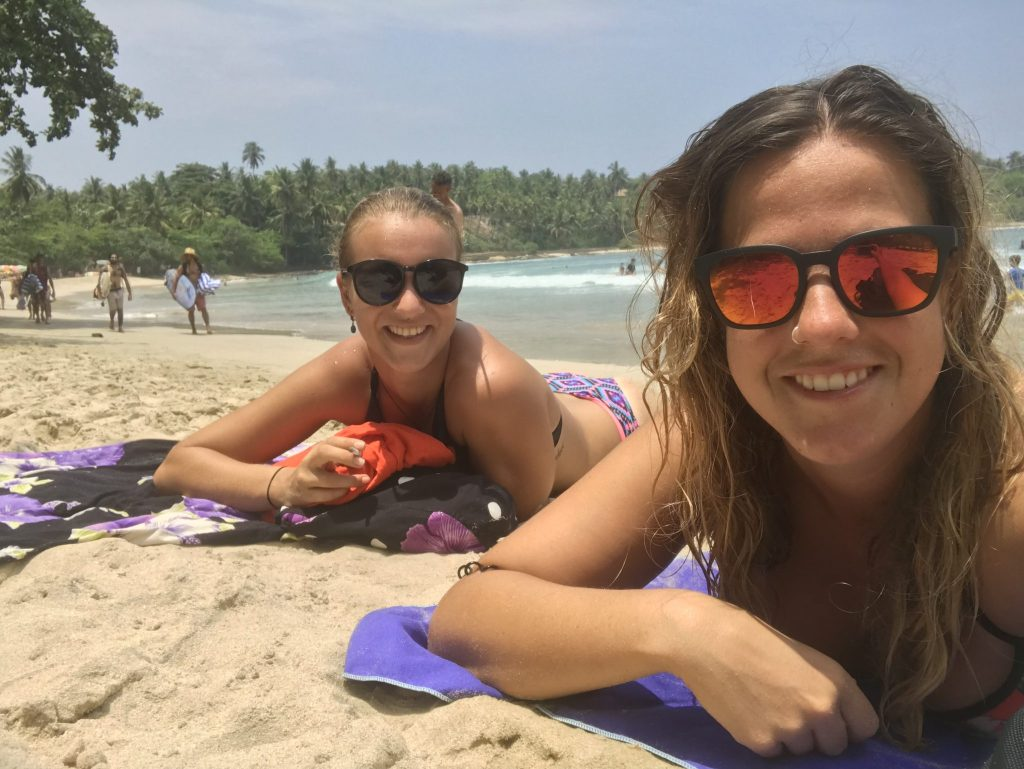 Two girls on the beach in Hiriketiya, Sri Lanka