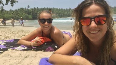 Two girls on the beach in Hiriketiya, Sri Lanka