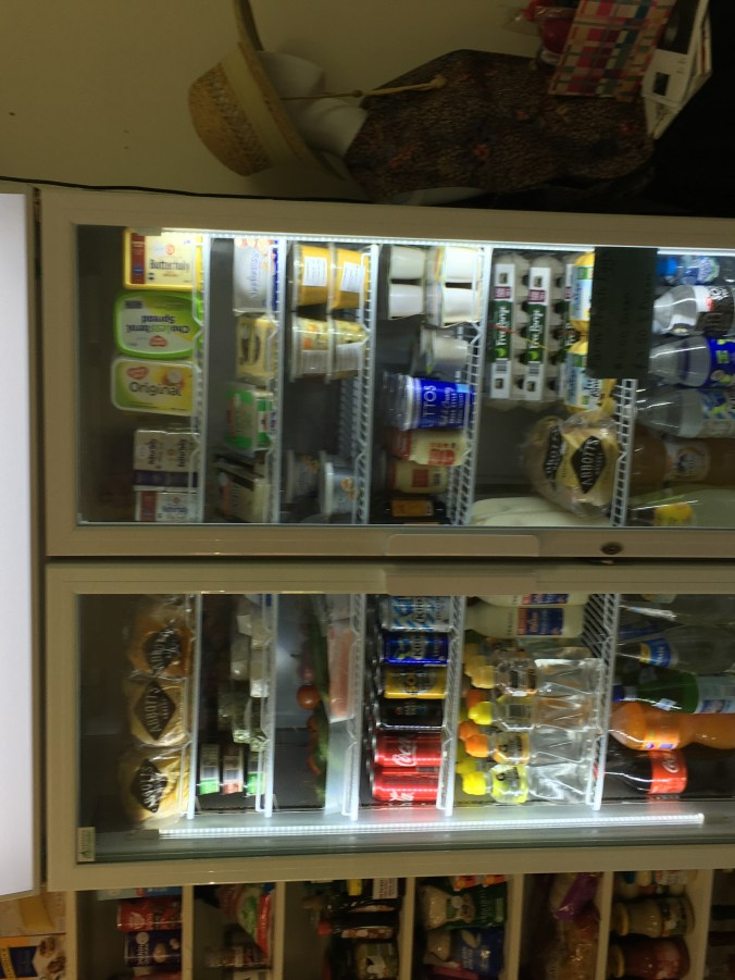 Refrigerator containing drinks, cheese, bread eggs, cream, milk helped residents during COVID-19