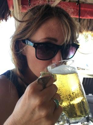 Me drinking my Landshark at Rojo Lounge- Ambergris Caye Belize