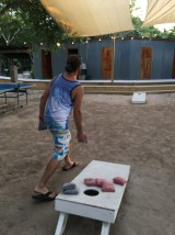 Rocky playing corn hole at The Truck Stop in Ambergris Caye Belize
