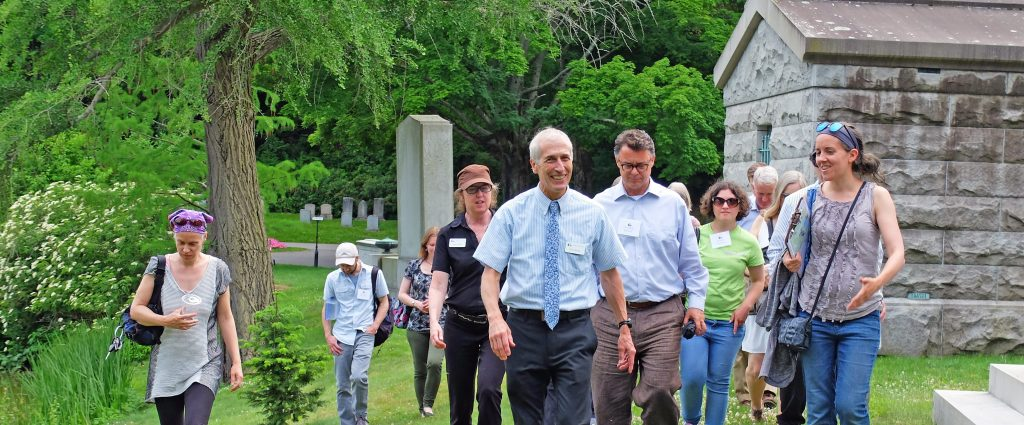 President Dave Barnett leads a spring walking tour.