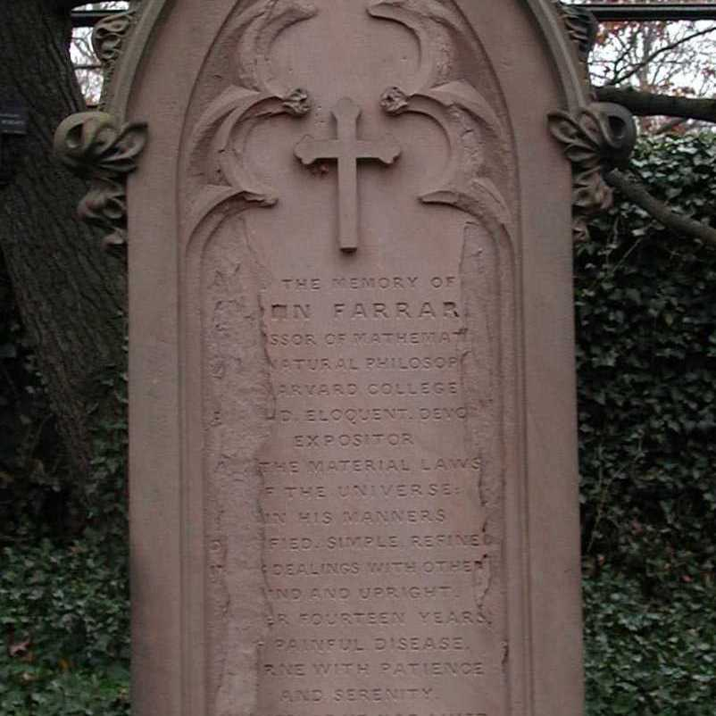 Gothic brownstone monument. The monument surface is delaminating obscuring some of the lengthy inscription.