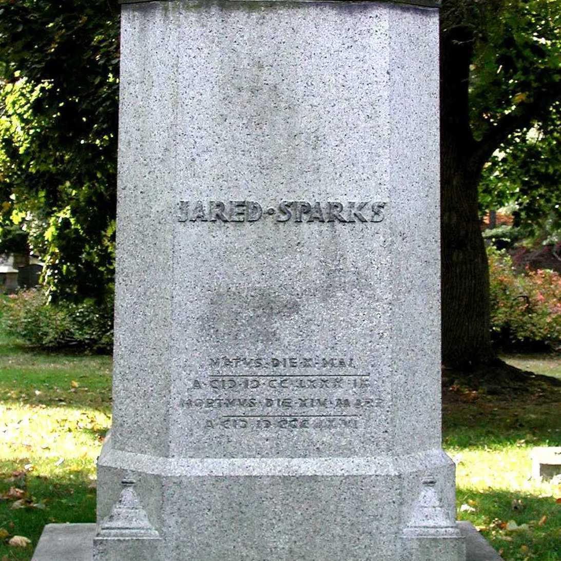 Square pedestal monument made of granite. There is some staining, but inscription remains completely legible.