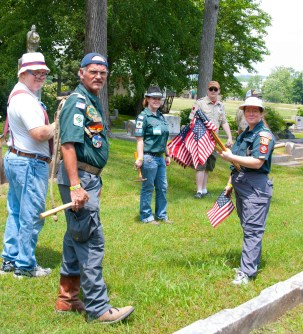 Volunteers are ready to place flags.