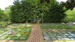Columbarium and bench, with Memorial Day flags for veterans