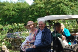 Guests are transported by golf cart to the center of the cemetery.