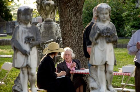 Association member Mary Fletcher Worthen framed by the statues of the Basham girls at the 2010 Spring Picnic