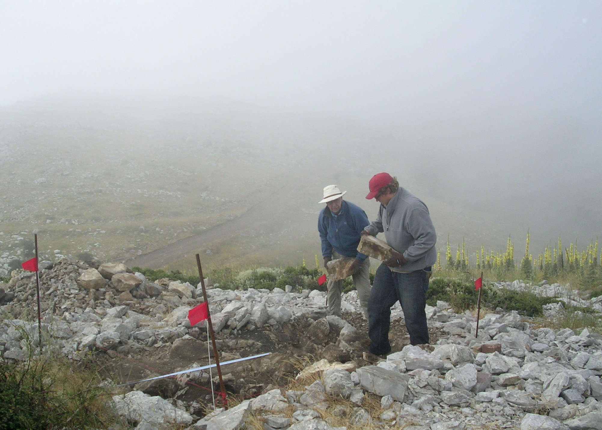 The geologists dig the fog at their ash altar trench
