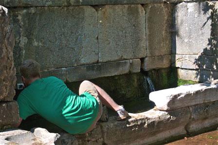 Erick Katzenstein studying the fountain house at Phigaleia