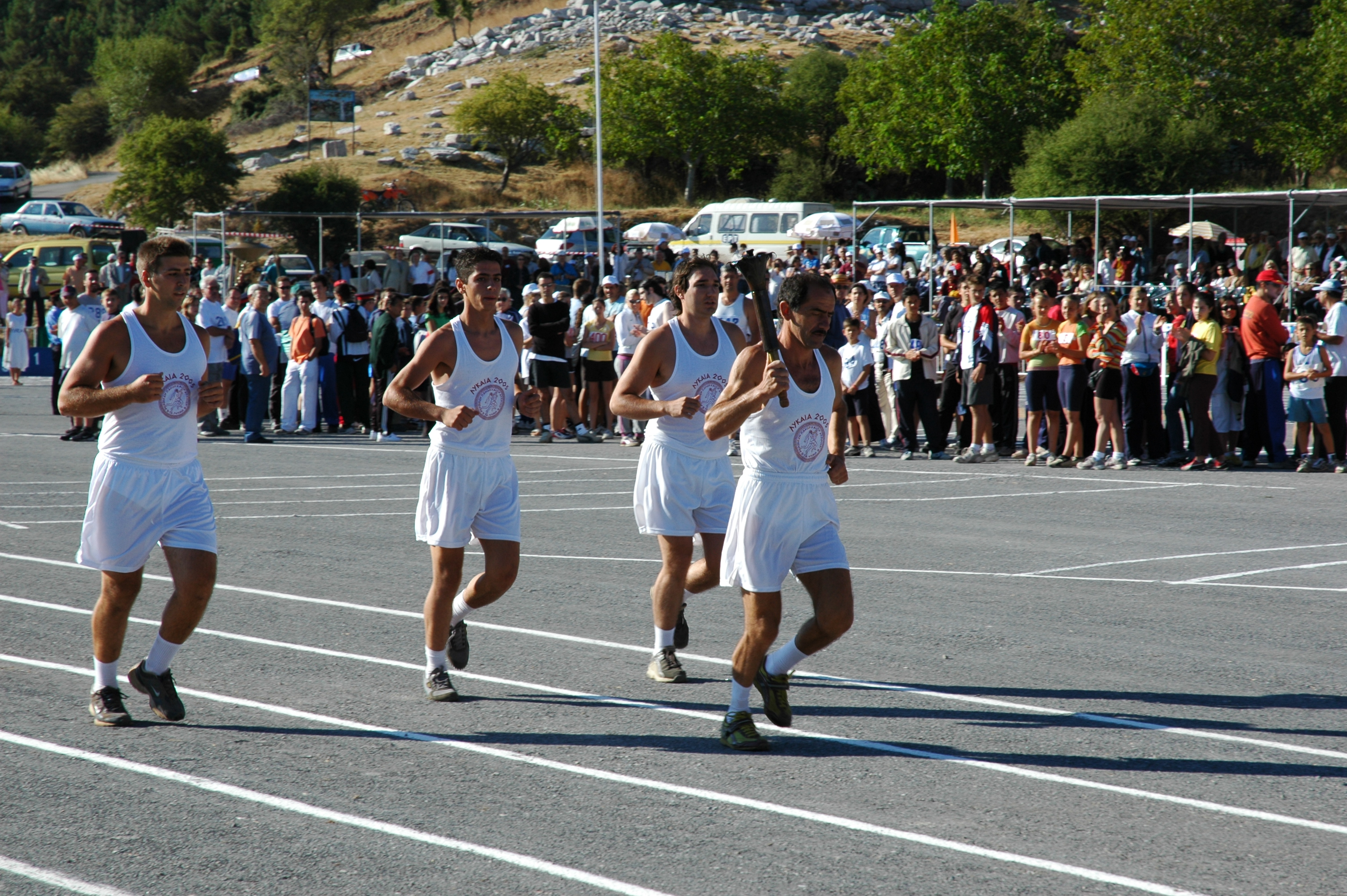 Flame brought to the track below the altar by Yanis Kouros (2005 photo)