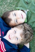 Brandon (4, top) and Joe (4, below) wear a green fleece by Hartstrings and a blue jacket with red and white detailing by London Fog proving there are several cozy ways to keep warm on a cool day. Outfits provided by Angels & Rascals.